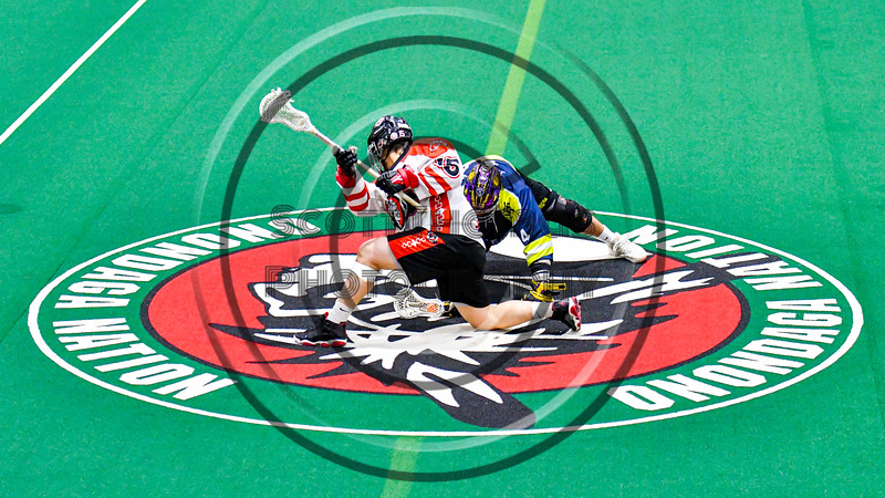 Onondaga Redhawks Cree Cathers (15) facing off against Allegany Arrows Cam Seneca (14) to start a Can-Am Box Lacrosse game at the Onondaga Nation Arena near Nedrow, New York on Saturday, May 25, 2019. Allegany won 12-8.