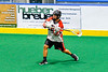 Onondaga Redhawks Wade Bucktooth (19) leans into a shot at the Allegany Arrows net in Can-Am Box Lacrosse action at the Onondaga Nation Arena near Nedrow, New York on Saturday, May 25, 2019. Allegany won 12-8.