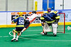 Onondaga Redhawks Mitch Laffin (7) attempts to score on Allegany Arrows goalie Craig Seneca (99) in Can-Am Box Lacrosse action at the Onondaga Nation Arena near Nedrow, New York on Saturday, May 25, 2019. Allegany won 12-8.