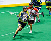 Allegany Arrows Devin Lepsch (33) cradling the ball against the Onondaga Redhawks in Can-Am Box Lacrosse action at the Onondaga Nation Arena near Nedrow, New York on Saturday, May 25, 2019. Allegany won 12-8.