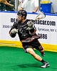 Akwesasne Bucks Zach Hopps (11) with the ball against the Onondaga Redhawks in Can-Am Box Lacrosse action at the Onondaga Nation Arena near Nedrow, New York on Friday, May 31, 2019. Akwesasne won 11-6.