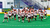 Onondaga Redhawks break their pre-game huddle before playing  the Akwesasne Bucks in a Can-Am Box Lacrosse game at the Onondaga Nation Arena near Nedrow, New York on Friday, May 31, 2019.