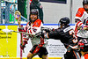 Onondaga Redhawks Kevin Bucktooth (25) with the ball against Akwesasne Bucks Derrick Hopps (3) in Can-Am Box Lacrosse action at the Onondaga Nation Arena near Nedrow, New York on Friday, May 31, 2019. Akwesasne won 11-6.