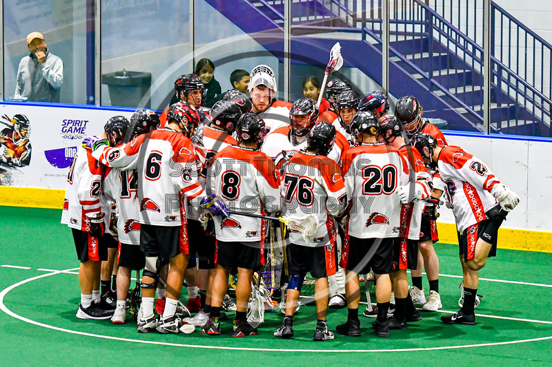 Onondaga Redhawks huddle up before playing  the Akwesasne Bucks in a Can-Am Box Lacrosse game at the Onondaga Nation Arena near Nedrow, New York on Friday, May 31, 2019.