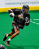 Akwesasne Bucks Alex Linder (4) running with the ball against the Onondaga Redhawks in Can-Am Box Lacrosse action at the Onondaga Nation Arena near Nedrow, New York on Friday, May 31, 2019. Akwesasne won 11-6.