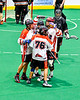Onondaga Redhawks players congratulate Lee Nanticoke (76) on his goal against the Akwesasne Bucks in Can-Am Box Lacrosse action at the Onondaga Nation Arena near Nedrow, New York on Friday, May 31, 2019. Akwesasne won 11-6.