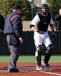 Will Salter (right), Orchard Lake St. Mary's, disputes a call with an official at home plate during varsity baseball action at Birmingham Brother Rice Wednesday, April 2, 2014. (Special to The Oakland Press / LARRY McKEE)