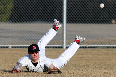 Devin Rose, Orchard Lake St. Mary's, comes up short after diving for a line drive during varsity baseball action at Birmingham Brother Rice Wednesday, April 2, 2014. (Special to The Oakland Press / LARRY McKEE)