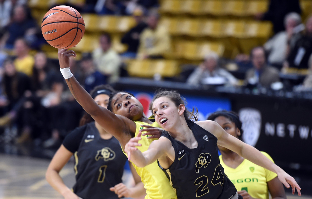 . Oti Gildon, of Oregon, and Aubrey Knight, of CU, reach for a rebound. For more photos of the game, go to Buffzone.com.  Cliff Grassmick / Staff Photographer/ January 26, 2018