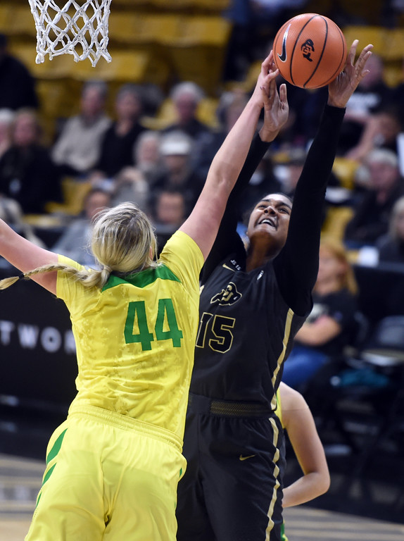 . Mallory McGwire, of Oregon, blocks the shot of Zoe Correal, of CU. For more photos of the game, go to Buffzone.com.  Cliff Grassmick / Staff Photographer/ January 26, 2018