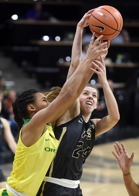 . Satou Sabally, of Oregon, and Aubrey Knight, of CU, battle for a rebound. For more photos of the game, go to Buffzone.com.  Cliff Grassmick / Staff Photographer/ January 26, 2018
