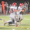 JIM VAIKNORAS/Staff photo Masconomet's Sean Evaul picks off a pass against Triton at Triton Friday night.