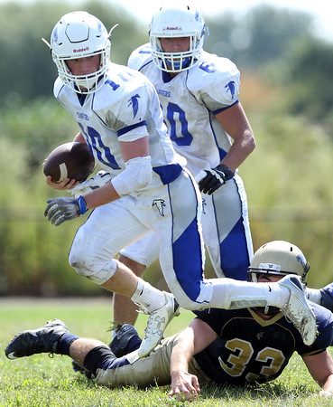 DAVID LE/Staff photo. Danvers junior Matt Andreas leaps out of a tackle and turns upfield. 9/12/15.