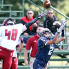 DAVID LE/Staff photo. Swampscott junior wide receiver Sean Lahrizi (2) concentrates on catching a deep pass down the left sideline which fell barely over the outstretched fingertips of Gloucester cornerback Andrew Latassa (48).  9/26/15.