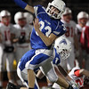 DAVID LE/Staff photo. Danvers junior Quintin Holland (33) celebrates his tackle of Melrose quarterback Julian Nyland for a loss of yards. 11/20/15.