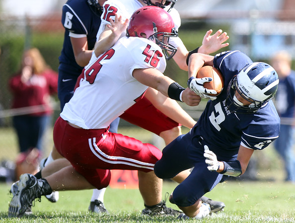 DAVID LE/Staff photo. Swampscott junior Sean Lahrizi (2) dives forward for a few extra yards while being brought down by Gloucester's Ryan Gabriele (46). 9/26/15.
