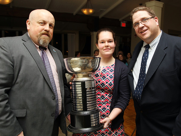 From left: Salem News editor David Olson, 2014 Salem News Student Athlete award winner Jillian Witwicki, of Pingree School, and Salem News Sports Editor Phil Stacey, after Witwicki was honored as the 52nd recipient of the ward on Thursday evening at Finz Restaurant in Salem. DAVID LE/Staff photo 4/3/14