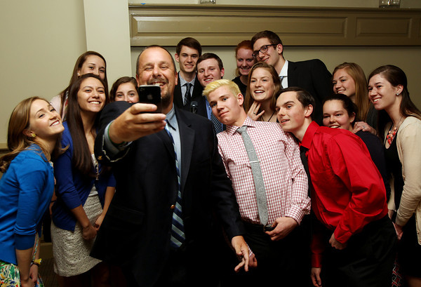 Guest speaker Rob Bradford, of Beverly, and current Red Sox writer and editor for weei.com, takes a selfie with the 2014 Salem News Student Athlete nominees at the awards banquet on Thursday evening at Finz Restaurant in Salem. DAVID LE/Staff photo 4/3/14