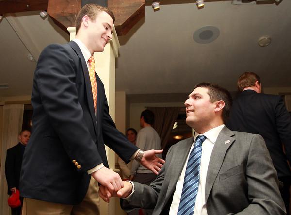 Salem: Beverly High School senior Brendan Flaherty shakes hands with guest speaker Pete Frates after the 51st Annual Salem News Student-Athlete Banquet. David Le/Salem News