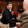 Salem: Pingree School senior Hossam Hamden shakes hands with Salem News Editor David Olson at the 51st Annual Salem News Student-Athlete Banquet. David Le/Salem News