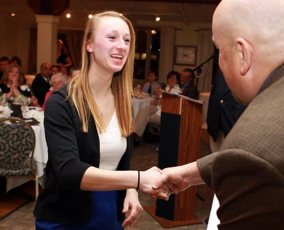 Salem: Essex Aggie senior Julianne DeGenova shakes hands with Salem News Editor David Olson at the 51st Annual Salem News Student-Athlete Banquet. David Le/Salem News