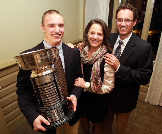 Salem: Masconomet senior Dylan Mann, winner of the 51st Annual Salem News Student-Athlete Award poses for a photo with his parents Kurt and Jill Mann after being presented with the trophy on Thursday evening. David Le/Salem News