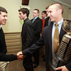Salem: Masconomet Regional High School senior Dylan Mann, right, winner of the 51st Annual Salem News Student-Athlete Award, shakes hands with Pingree School's Hossam Hamden, after being named the winner on Thursday evening. David Le/Salem News