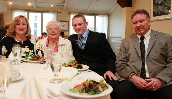 Salem: Salem News Student-Athlete nominee Duncan d'Hemecourt with his parents Susan and Martin, and his grandmother Edith Grigor, at the 51st Annual Salem News Student-Athlete Banquet. David Le/Salem News