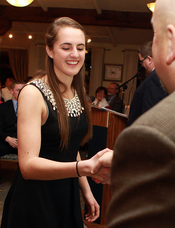 Salem: Manchester-Essex senior Carolyn Heslop shakes hands with Salem News Editor David Olson at the 51st Annual Salem News Student-Athlete Banquet. David Le/Salem News