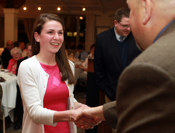 Salem: Ipswich High School senior Sarah Keiran shakes hands with Salem News Editor David Olson as she is presented with a photograph at the 51st Annual Salem News Student-Athlete Banquet at Finz on Thursday evening. David Le/Salem News