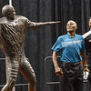 Marlin Briscoe sizes up his statue after unveiling it with Tra-Deon Hollins in Baxter Arena. UNO Basketball player Tra-Deon Hollins was the model for the statue. <br /> <br /> Sept. 23, 2016