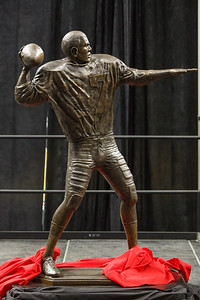 Marlin Briscoe statue unveiling in Baxter Arena. UNO Basketball player Tra-Deon Hollins was the model for the statue.   Sept. 23, 2016