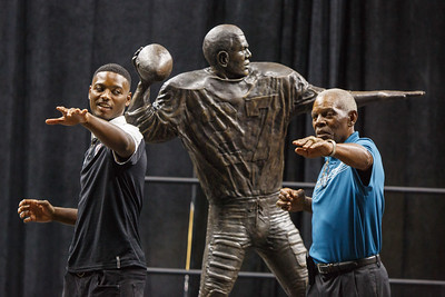 Marlin Briscoe and Tra-Deon Hollins strike a pose after the statue unveiling in Baxter Arena. UNO Basketball player Tra-Deon Hollins was the model for the statue.    Sept. 23, 2016
