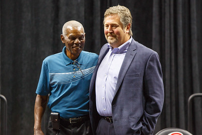 Marlin Briscoe with the statue artist after its unveiling in Baxter Arena. UNO Basketball player Tra-Deon Hollins was the model for the statue.   Sept. 23, 2016
