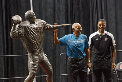 Marlin Briscoe sizes up his statue after unveiling it with Tra-Deon Hollins in Baxter Arena. UNO Basketball player Tra-Deon Hollins was the model for the statue.   Sept. 23, 2016