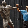 Marlin Briscoe sizes up his statue after the unveiling in Baxter Arena. UNO Basketball player Tra-Deon Hollins was the model for the statue. <br /> <br /> Sept. 23, 2016