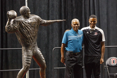 Marlin Briscoe poses for photos after unveiling his statue with Tra-Deon Hollins in Baxter Arena. UNO Basketball player Tra-Deon Hollins was the model for the statue.   Sept. 23, 2016