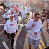 Matt Hamilton/The Daily Citizen<br /> Runners walk to the starting point of the 5k color run Saturday morning.
