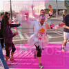 Matt Hamilton/The Daily Citizen<br /> Volunteers throw dye on runners as they participate in the 5k color run Saturday morning in downtown Dalton.