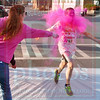 Matt Hamilton/The Daily Citizen<br /> Tasha Waskul accidentally tosses a cup full of dye in the face of lead runner Luis Hernandez, 12, sidelining him momentarily as he rinsed the dye out of his eyes and mouth before continuing the race Saturday.