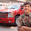 Matt Hamilton/The Daily Citizen<br /> Braxton Bates, 12, with his 2013 Chevy Silverado extended cab Wednesday  in Chatsworth.