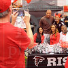 Matt Hamilton/The Daily Citizen<br /> Atlanta Falcon cheerleaders Rie, left, and Ariel, middle, and former Falcons player William Andrews pose for pictures and sign autographs at Home Depot Thursday.