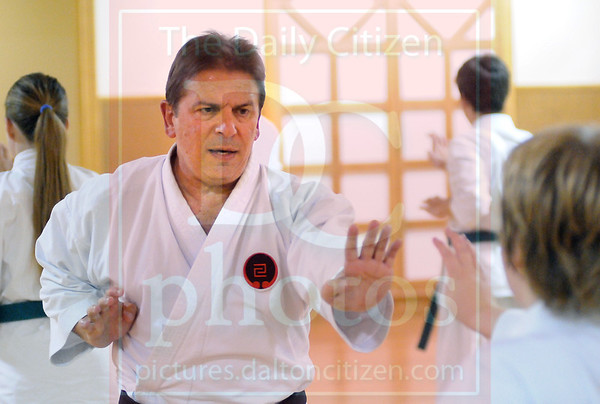Matt Hamilton/The Daily Citizen<br /> Mickey Brock works with Alex Gibson, 13, at his dojo Thursday.
