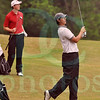 Matt Hamilton/The Daily Citizen<br /> D Jacob Brown looks on as NW Ethan Hayes plays up to the green on #14 Tuesday.