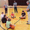 Matt Hamilton/The Daily Citizen<br /> Coach Ingle talks to the youths in his basketball camp Friday at First Presbyterian Church.