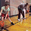 Matt Hamilton/The Daily Citizen<br /> Madison Nelson, 10, dribbles a ball with Ladaris Green at First Presbyterian Church Friday.