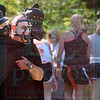 Matt Hamilton/The Daily Citizen<br /> Ken Rajtar of Powder Springs, Ga. sprays water on runners from a doll head on his shoulder Saturday during the race.