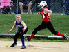 Harleysville's Melissa Peters makes it to first base on an error by Deep Run's Lauren Howe.<br /> Bob Raines--Montgomery Media