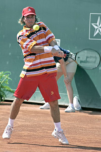 Vince Spadea returns a volley against Mardy Fish in quarterfinals action at the U.S. Men's Clay Court Championships, April 14,2006.  Fish defeated Spadea 4-6,7-6,6-4 to advance to the semifinals.