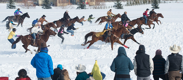 DeWinton, Alta _ Feb. 10, 2018 _ Riders on horseback pull one skier down the course and another skier for the return trip in the skijor relay. Skijor is a Norwegian word meanng ski driving where persons on skis and snowboards are pulled by a horse, dog or motor vehcle. In DeWinton, it's called Skijordue which began as a private event that combined skijor and fondue and apres ski. It started as a private event for a dozen people and has grown to more than 1000 where there is a good chance of seeing top rodeo cowboys pulling top skiers. Skijor Canada is now a fast_growing sport with events throughout Alberta.  (Mike Sturk photo)